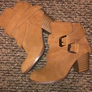 Soft fake fuzzy leather tan heeled boots.